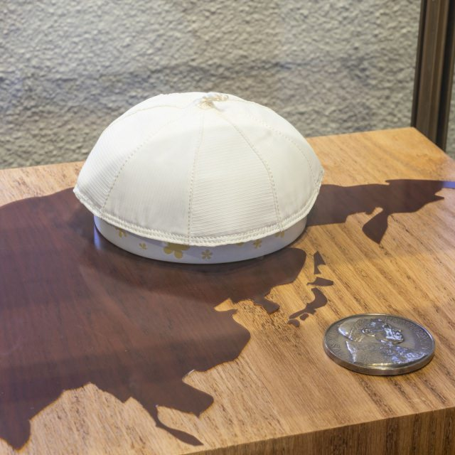 Europe map and Skullcap worn by Pope Pius XII and medal given to the Little Sisters of the Holy Family in 1957 by Cardinal Paul Emile Léger, Archbishop of Montréal